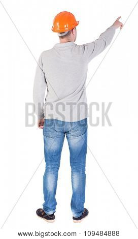 Back view of  pointing young men in  shirt and helmet. Young guy  gesture. Rear view people collection.  backside view of person.  Isolated over white background.
