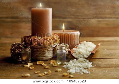 Beautiful relax composition with candles on wooden background