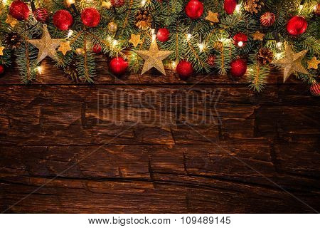 Christmas decoration with fir branches on wooden planks. Copyspace for text