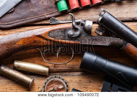 The Hunting Rifle, Cartridge Belt,binoculars On A Wooden Table