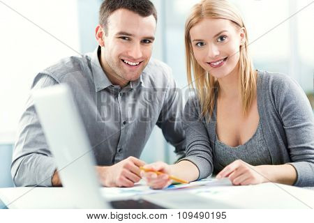 Young couple working together