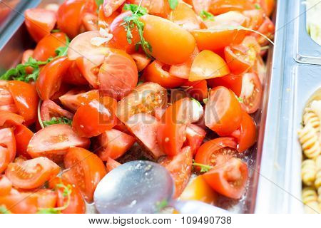 food, catering, eating and cooking concept - close up of tomato salad in metallic container