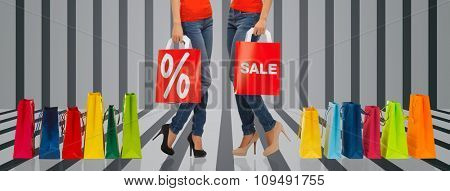 people, sale and discount concept - close up of women with percentage sign on red shopping bag over gray striped 3d background