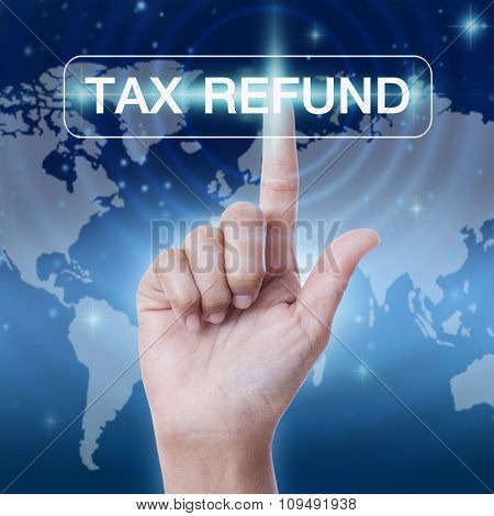 hand pressing tax refund word button on virtual screen. business concept