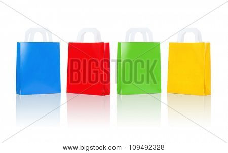 sale, consumerism, advertisement and retail concept - many blank colorful shopping bags