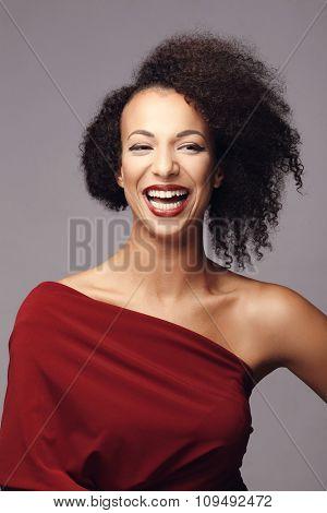 Beautiful woman on a gray background