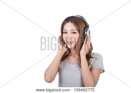 Woman enjoy the music by using earphones.