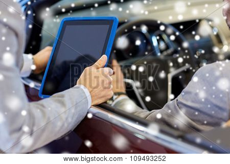 auto business, car sale, consumerism and people concept - close up of men with tablet pc computer and cabrio in auto show or salon over snow effect