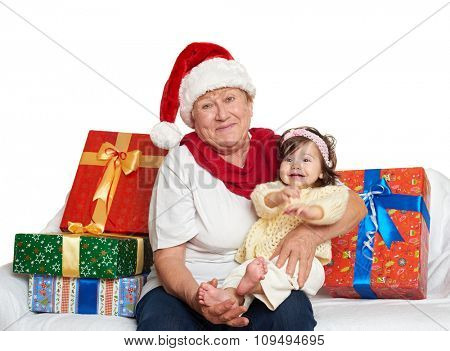 happy grandmother and granddaughter with christmas box gift - holiday concept