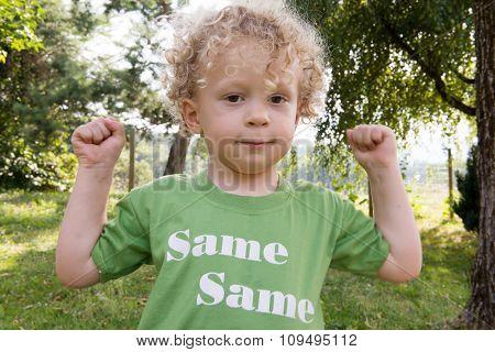 Portrait Of A Little Blond Curly Boy