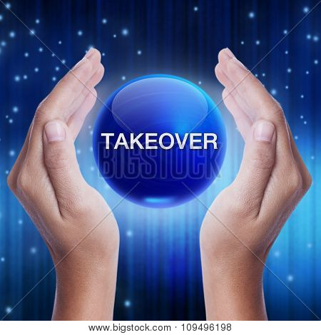 Hand showing blue crystal ball with takeover sign.