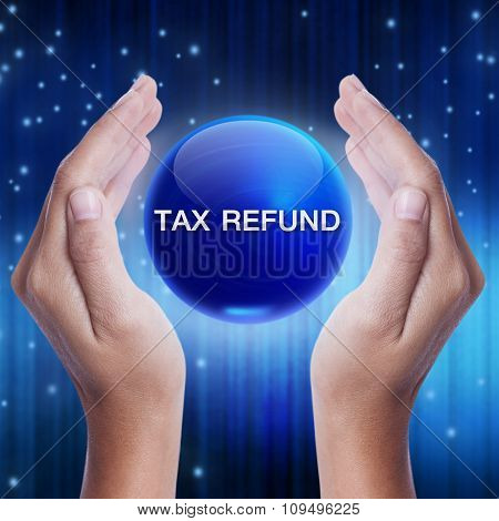 Hand showing blue crystal ball with tax refund sign. business concept