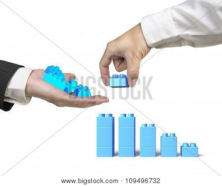 One Hand Holding Stack Blocks The Other Completing Bar Graph