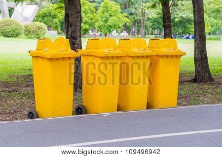 Trash Cans In The Park Beside The Walk Way