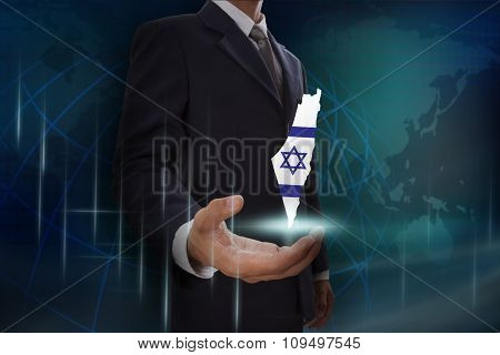 Businessman showing map of Israel on globe background