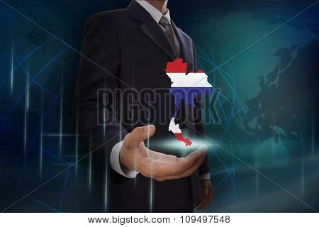 Businessman showing map of Thailand on globe background