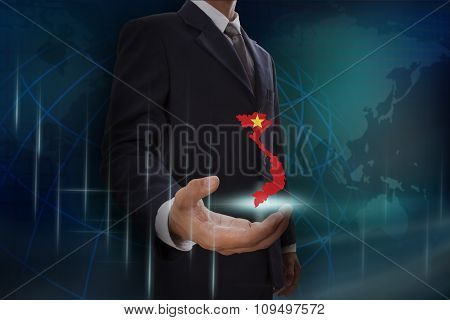 Businessman showing map of Vietnam on globe background