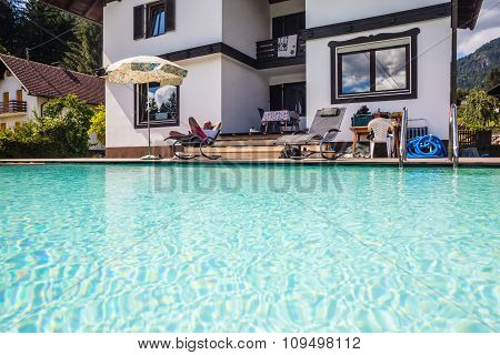 Relaxing On The Poolside