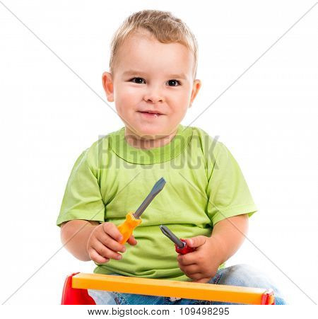 little boy sitting and playing toy tools isolated on white background