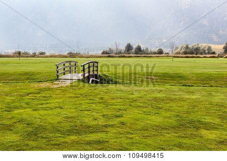 Small Wooden Bridge On Golf Course
