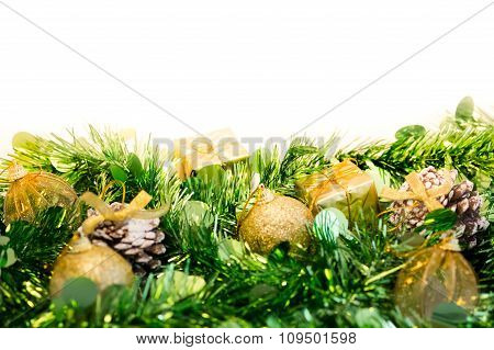Christmas Baubles And Green Tinsel. Isolated On White Background With Copy Space