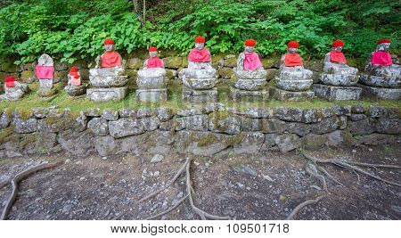 Front view of moss covered statues of Jizo in Nikko