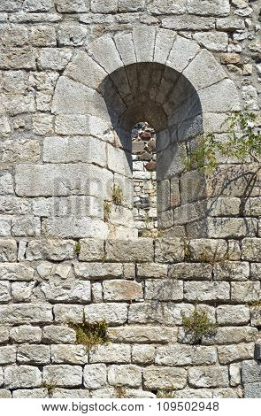 The window in the stone, medieval wall