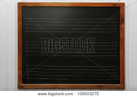 Lined blackboard on the wall in the classroom