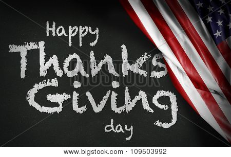 Happy Thanks Giving Day written on blackboard and the USA flag