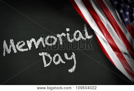 Memorial Day written on blackboard and the USA flag