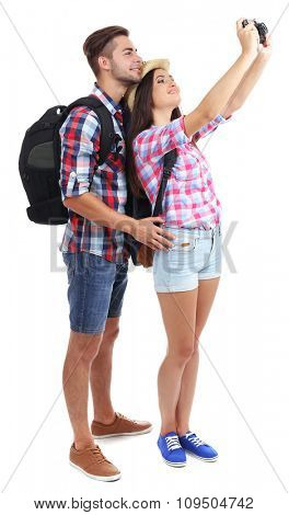 A pair of happy tourists sightseeing in summer, isolated on white