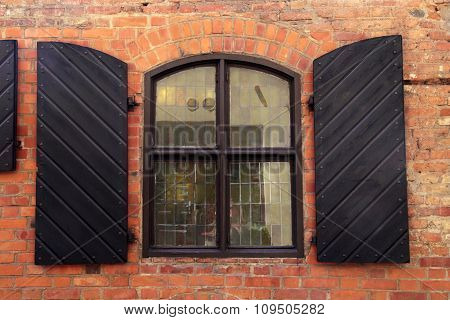 Wall Of Red Brick With Window And Shutters