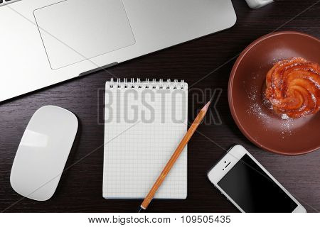 Close-up of comfortable working place on wooden background, top view