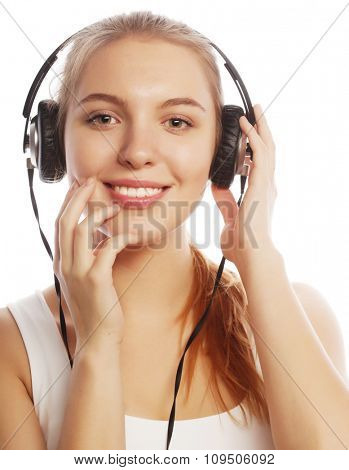 Woman with headphones listening music . Music teenager girl isolated on white.