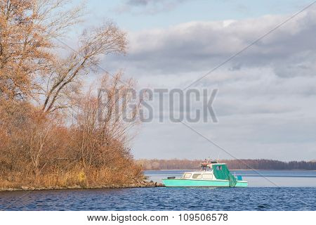 Green Vintage Boat On The River