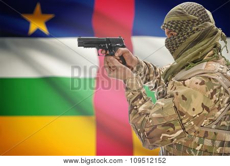 Male In Muslim Keffiyeh With Gun In Hand And National Flag On Background - Central African Republic