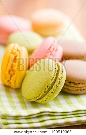 tasty colorful macarons on wooden table