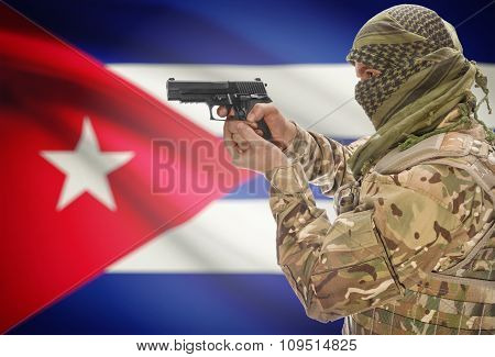 Male In With Gun In Hand And National Flag On Background - Cuba
