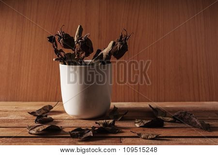 Leaf Of Rose Fall On Wooden Table