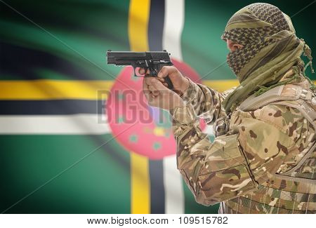 Male In Muslim Keffiyeh With Gun In Hand And National Flag On Background - Dominica