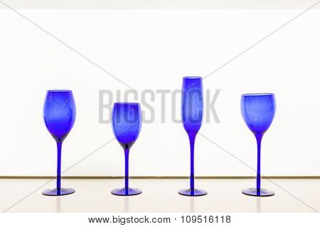 isolated empty blue goblet against white background
