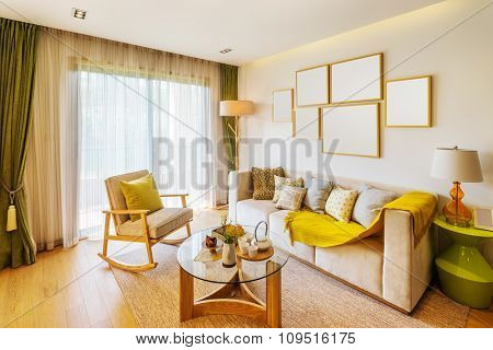 interior of living room with big window and beautiful couch
