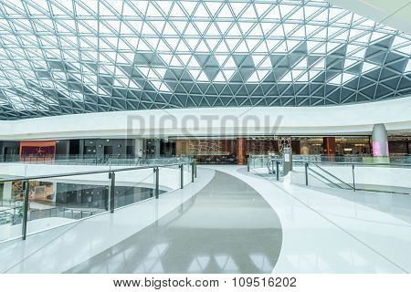 empty hallway and abstract ceiling in shopping mall