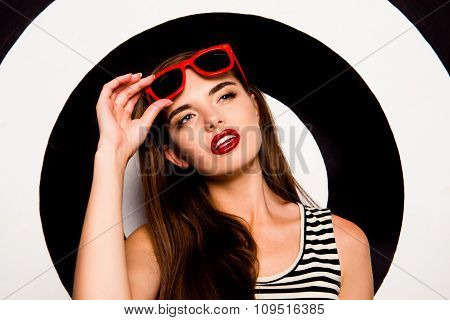 Glamorous Confident Girl Holding Glasses Against The Background Of Circles