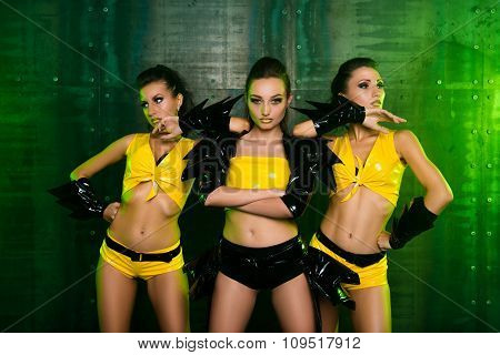 Three Sexy Cute Posing Girls In Stage Yellow Costumes