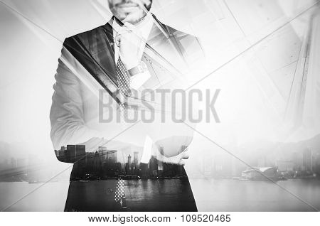 Photo of businessman wearing suit and thinking. Double exposure city at sunrise. Horizontal