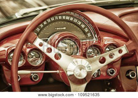 Sleza, Poland, August 15, 2015: Close Up On Corvette Vintage Car Steering Wheel And Kockpit On  Moto