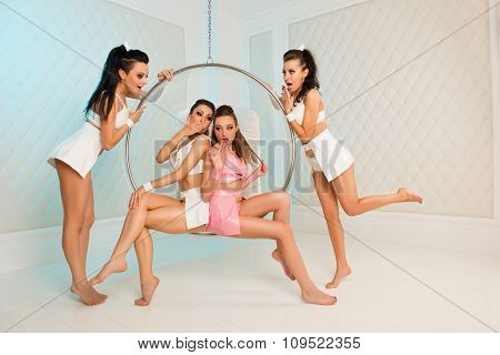 Four Sexy Cute Girls With Roand Chair Gossiping
