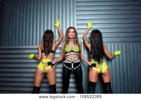 Three Confident Pretty Sexy Girls In Stage Costumes