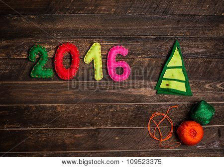 2016 Christmas Tree Made Of Felt. Childish New Year Background With Christmas Toy From Felt On Dark